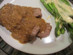 Alton's pot roast served with sauce.