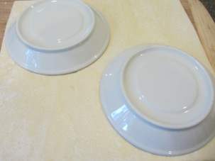 Using two small saucers as templates.