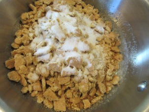 Graham cracker pieces combined with melted butter and sugar for crust.