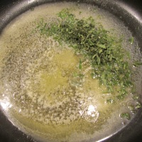 Melted butter and chopped sage in a hot skillet.