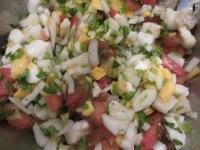 Fish and veggies, tossed to combine.