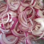 Sliced red onion.