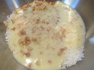 Shredded coconut, macadamia nuts, sweetened condensed milk, and almond extract.