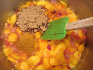 Brown sugar, curry powder, mango juice, and cider vinegar in the pot.