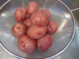 Potatoes, drained after cooking for about 20 minutes.