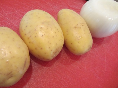 3 Yukon Gold potatoes and 1 onion.