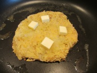 Butter dispersed on top of roesti.