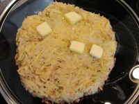 Roesti on pan lid to flip back into skillet.