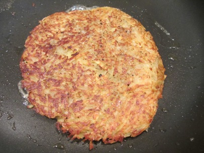 Roesti after flipping back into skillet.