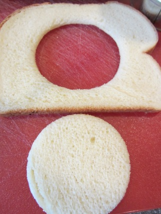 Rounds cut out of each slice of potato bread.