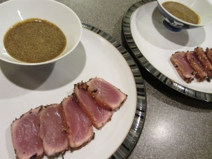 Seared tuna served with reserved marinade as a dipping sauce.