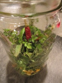Herbs placed in a mason jar.