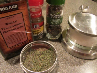Ingredients for turkey dry rub: Kosher salt, dry thyme, rubbed sage, black peppercorns, and allspice berries.