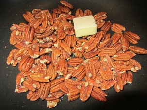 Butter added to pecans.
