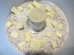 Cold butter cubes added to food processor.