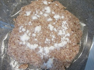 Cooled crust dough, sprinkled with flour before being rolled out.