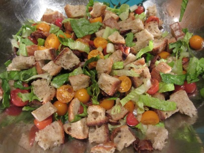 Bread cubes added to salad.