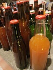 Sealed bottles of Alton's homebrew.