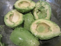 Three avocados, tossed in lime juice.