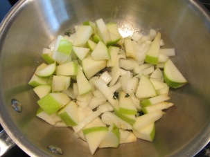 Onion, apple, thyme, and Kosher salt added to melted butter.