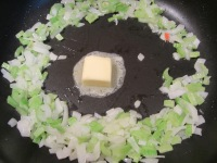 Butter added to the center of the pan.