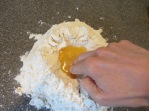 Stirring wet ingredients into dry.