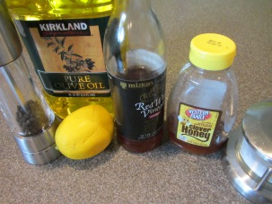Dressing ingredients: red wine vinegar, lemon juice, honey, Kosher salt, pepper, and olive oil.