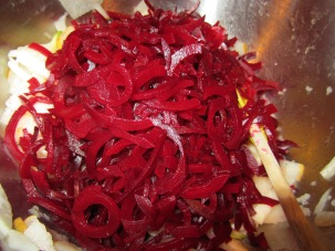 Spiralized beets added to bowl.