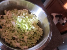 Napa cabbage and pepper, added to the bowl.