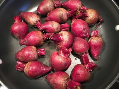Cleaned baby beets in the skillet.