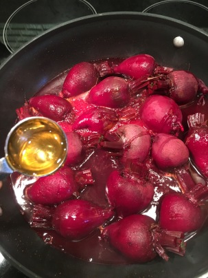 Adding white balsamic vinegar and honey to the beets.