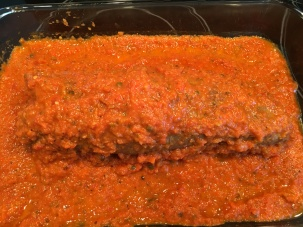 Hot tomato sauce spooned over braciole.