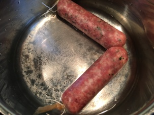 Sausage links placed in lidded pan with 1/4-inch of water.
