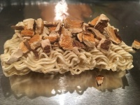 Half a block of Ramen noodles per diner, plus dried mushrooms.