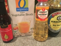 Liquid ingredients: sesame oil, vegetable broth, mirin, and soy sauce.
