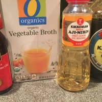 Liquid ingredients: sesame oil, vegetable broth, mirin, and soy sauce.