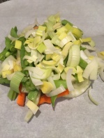 1/3 C carrots, 1/3 C fennel, 1/3 C snow peas, and 1/3 C leeks on right side of parchment heart.