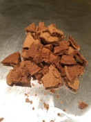 Crushed gingersnap cookies in the center of each foil square.