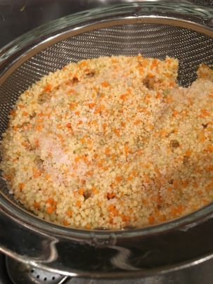 Couscous, rinsed in cold water and sprinkled with Kosher salt.