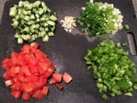Chopped cucumber, garlic, scallions, tomato, and bell pepper.