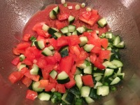 Garlic, scallions, cucumber, tomato, and bell pepper added to bulgur.
