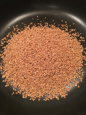 Wheat berries, toasting in a dry skillet.