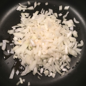 Onion added to skillet.
