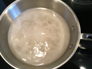 Sugar and water being brought to a boil.