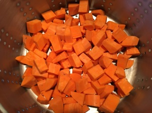 Cubed sweet potatoes in the steamer.