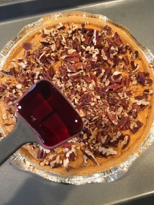 Pie, topped with toasted/chopped pecans and 1 T maple syrup.