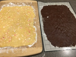 Peppermint and chocolate dough rectangles. Chocolate rectangle is slightly longer and thinner.