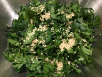 Parsley and toasted sesame seeds folded into dressing.