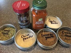 Spices for Alton's pomade: star anise, cayenne pepper, garlic powder, cumin seed, coriander, onion powder, and fennel seed.