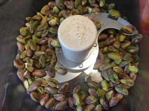 Pistachios in food processor.